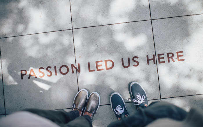 "A word written on the floor ""Passion led us here"" - EQ Asia"
